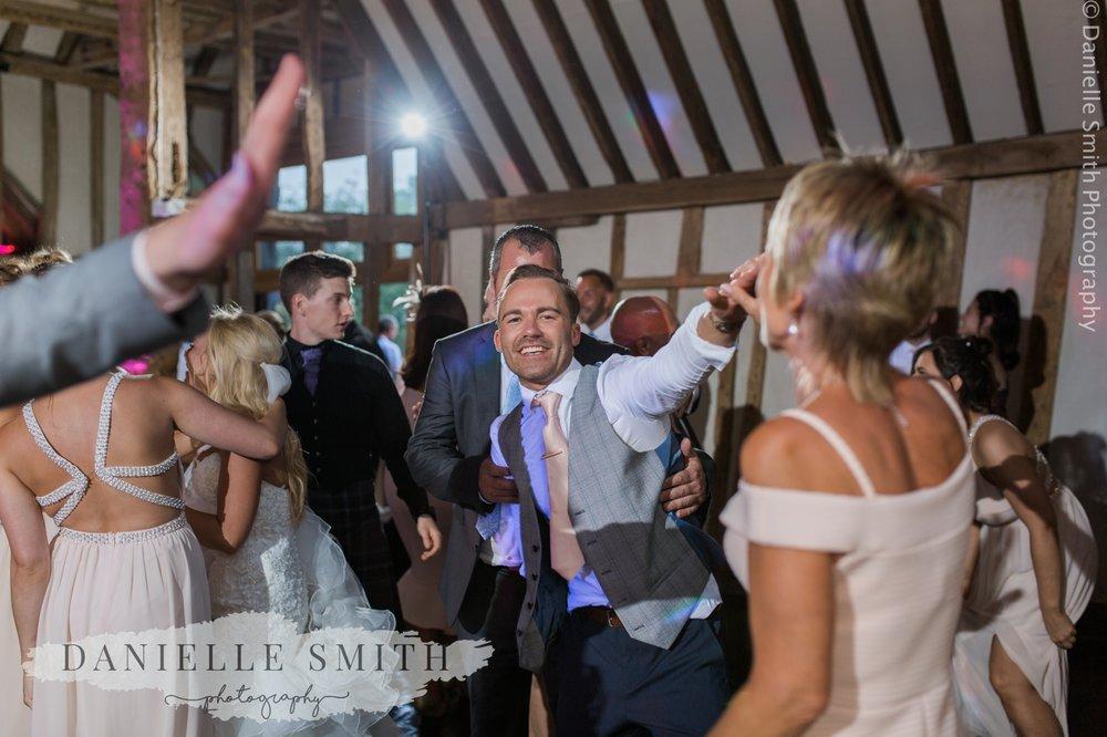 groom dancing into night
