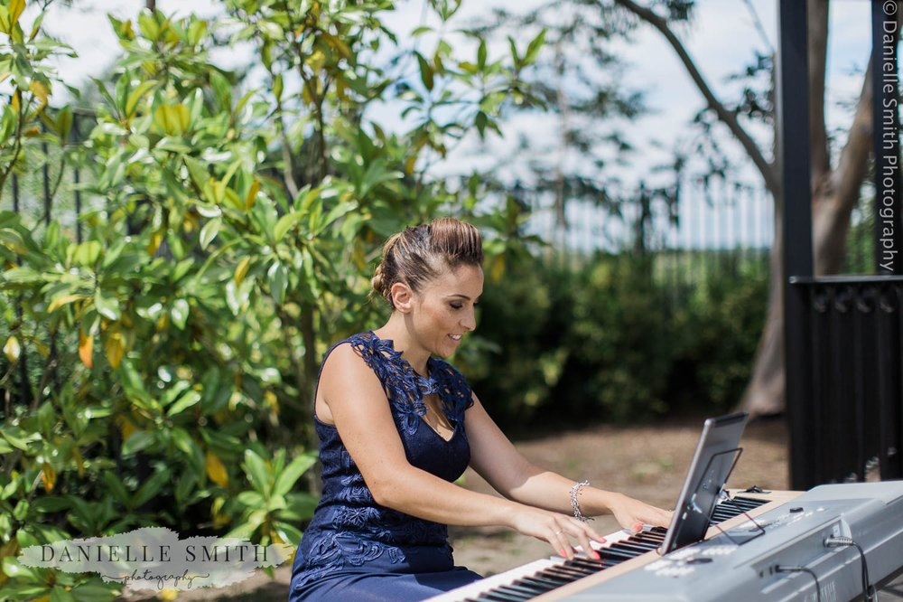 pianist at outdoor wedding