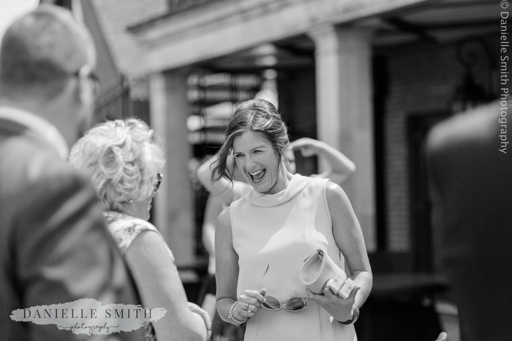 lady laughing at wedding