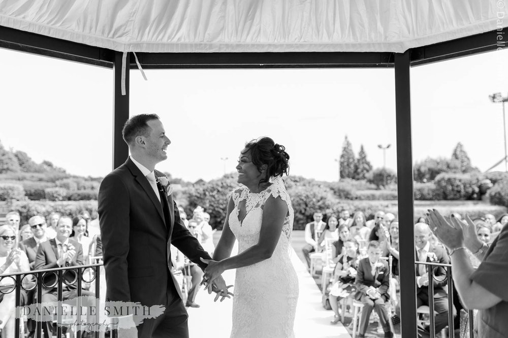 bride and groom laughing at outdoor wedding ceremony