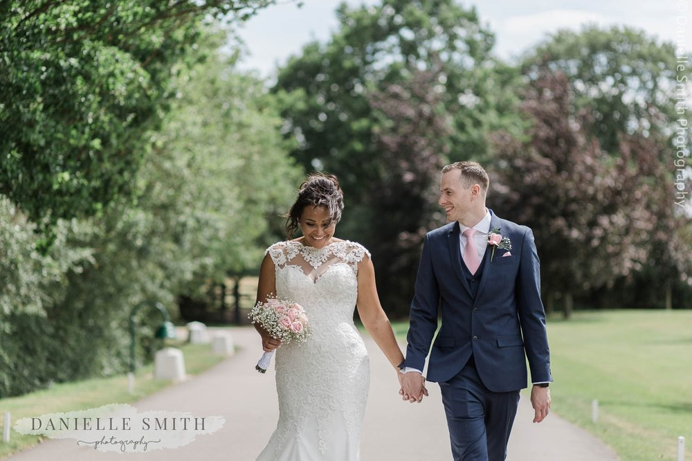 bride and groom smiling and walking together