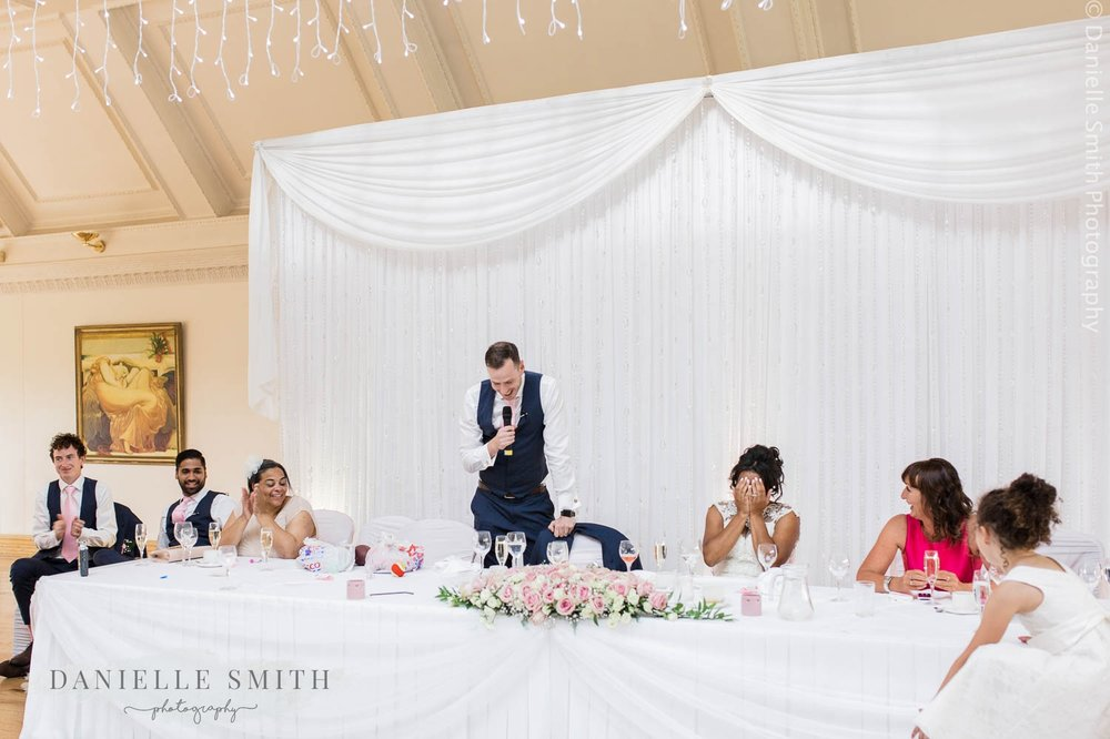 top table while groom gives speech