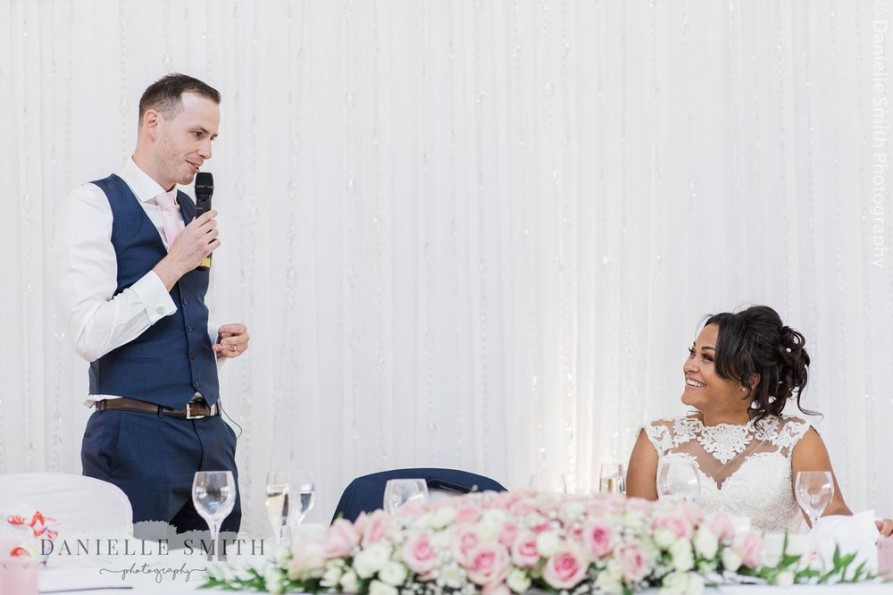 groom giving speech to his wife