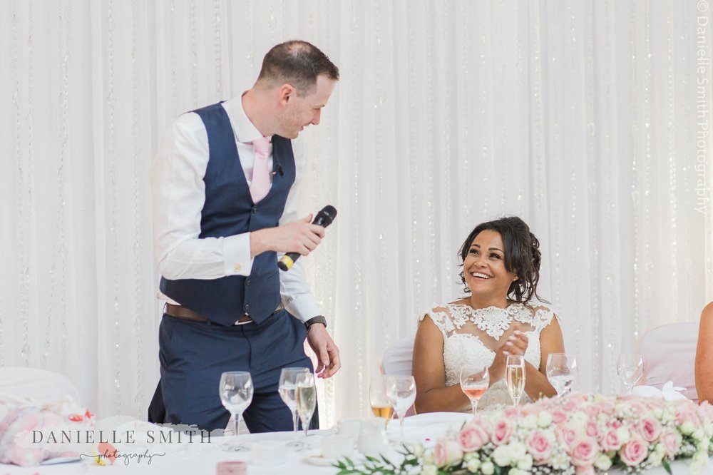 bride and groom during speeches at stock brook manor