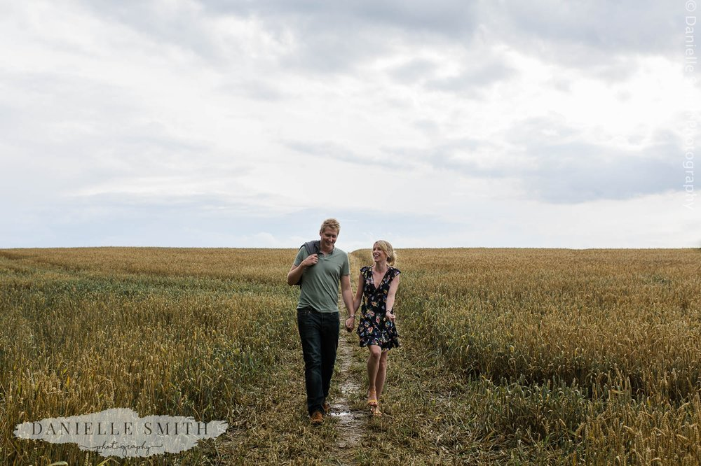 couple walking through corn field