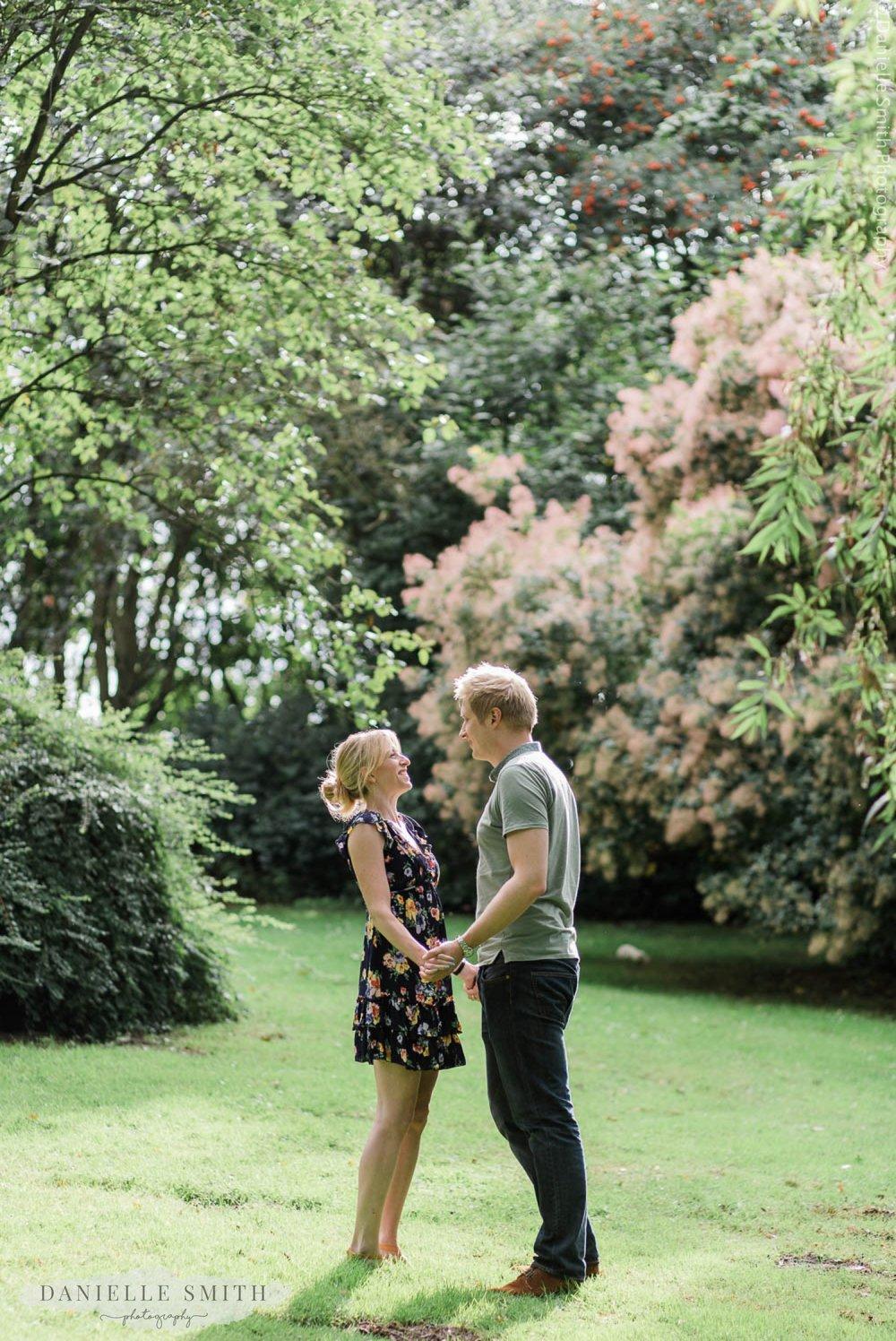 couple standing in gardens