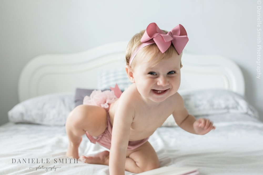 little girl crawling and smiling