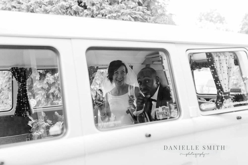 bride and groom through camper van window
