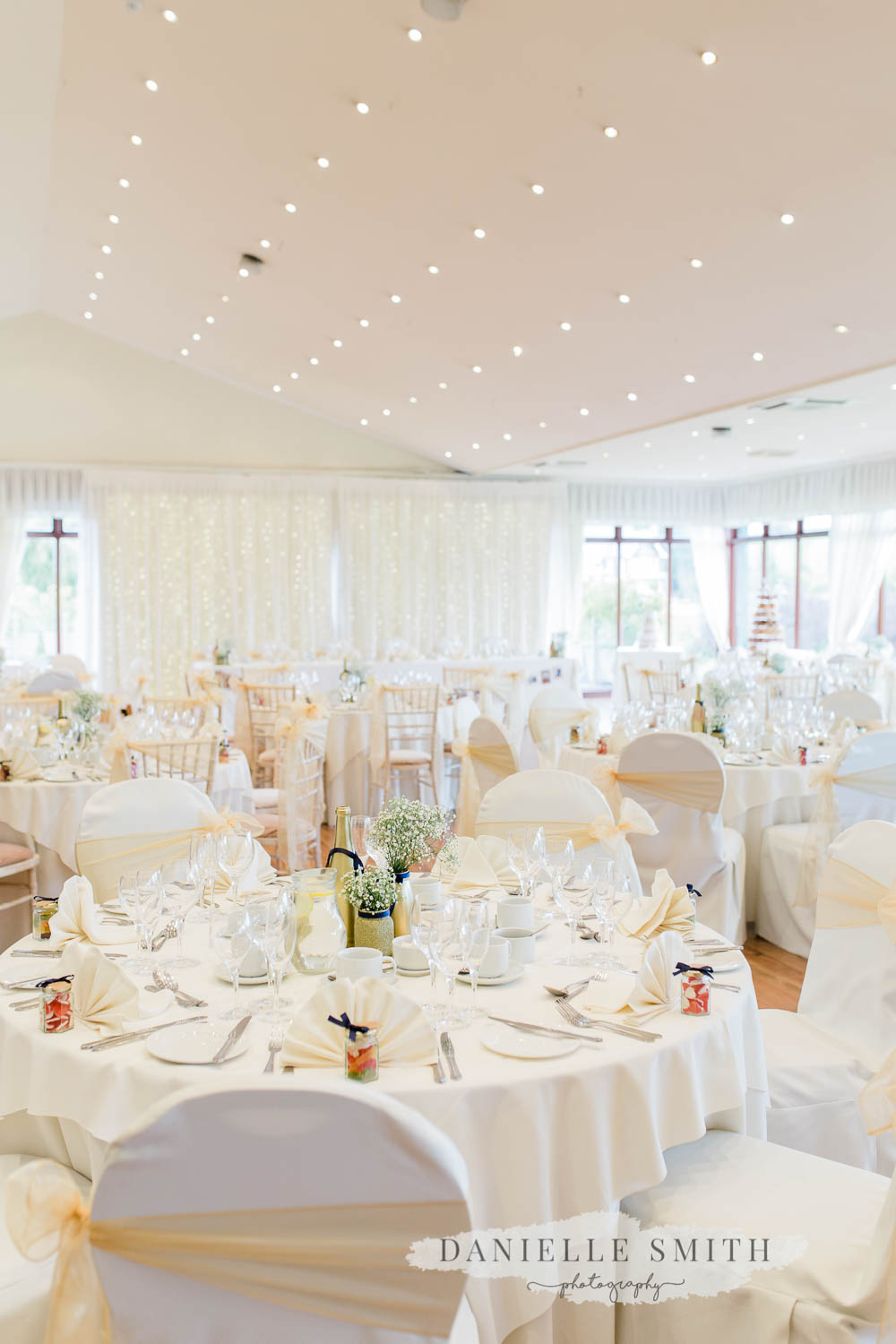 white and gold wedding reception room
