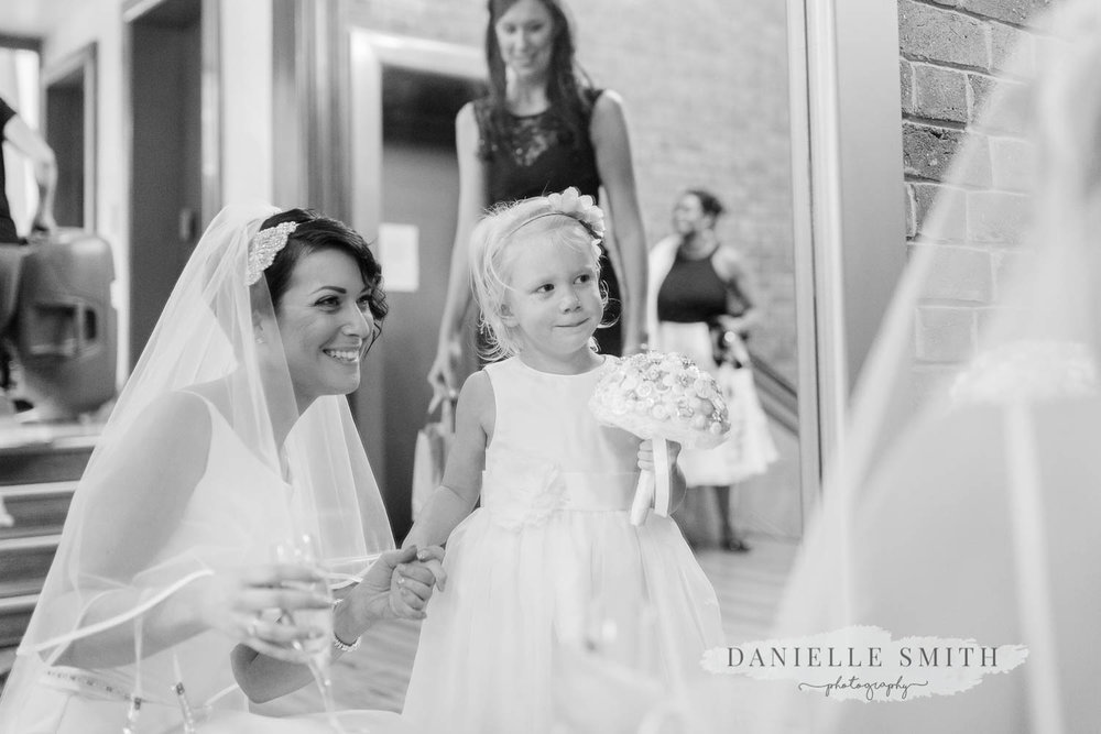 bride and flower girl smiling