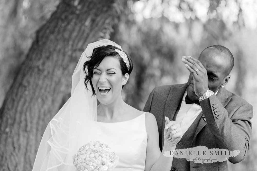 bride laughing - laid back wedding