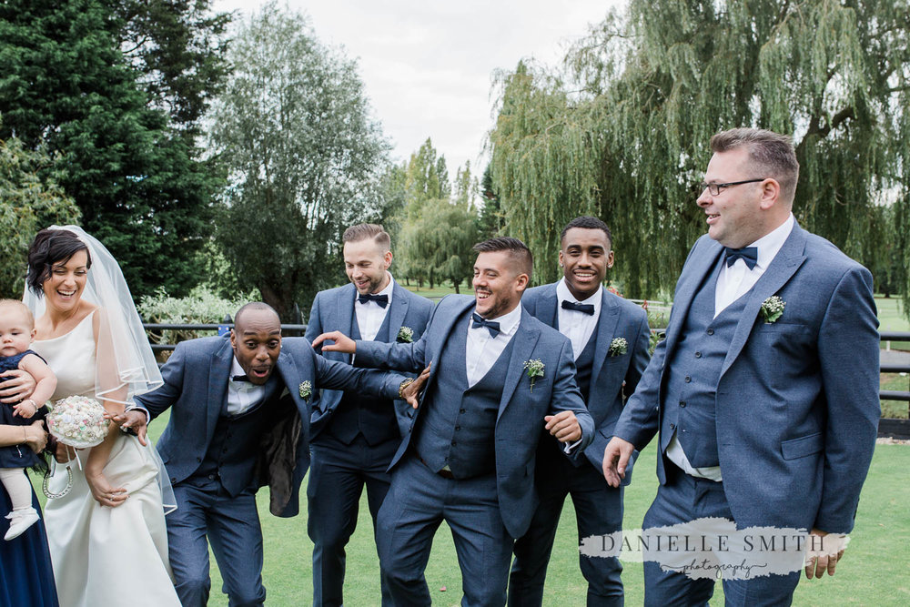 groom and groomsmen messing around