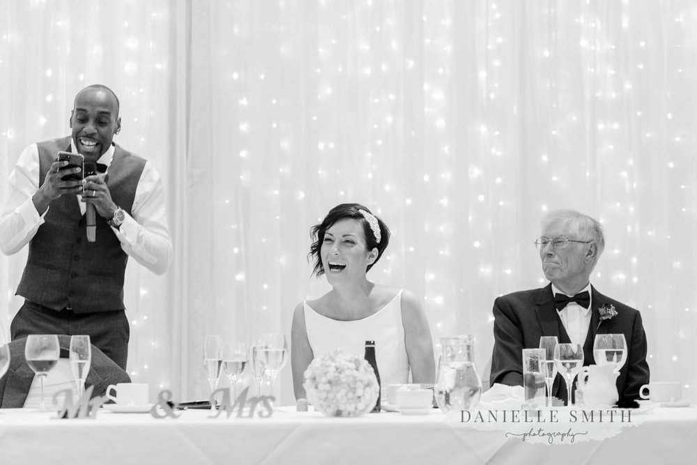 grooms speech bride laughing - laid back wedding