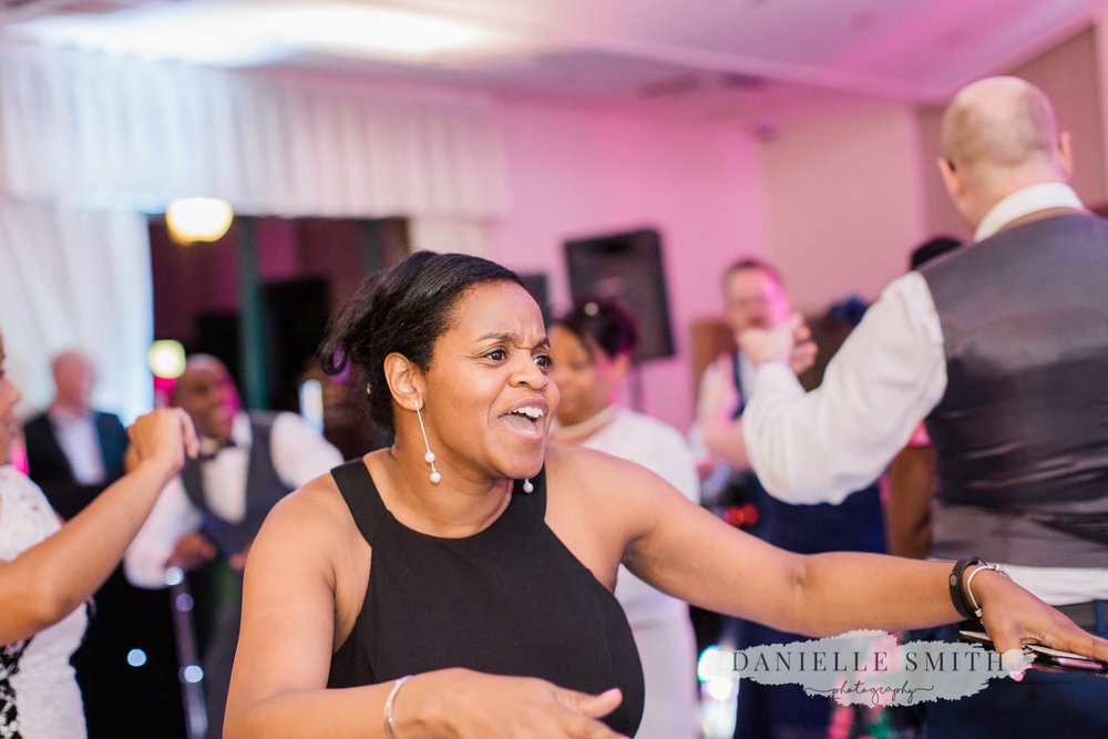 wedding guest dancing an singing