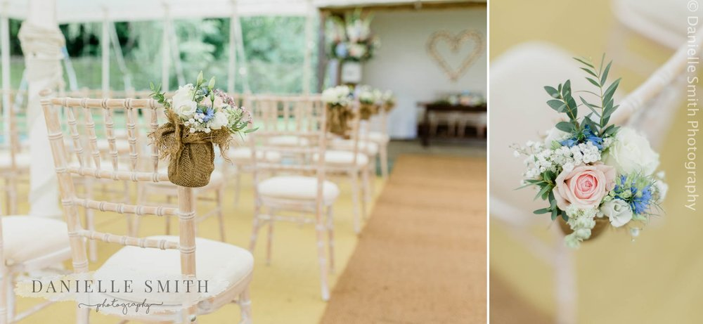 pastel flowers hanging on chairs at houchins