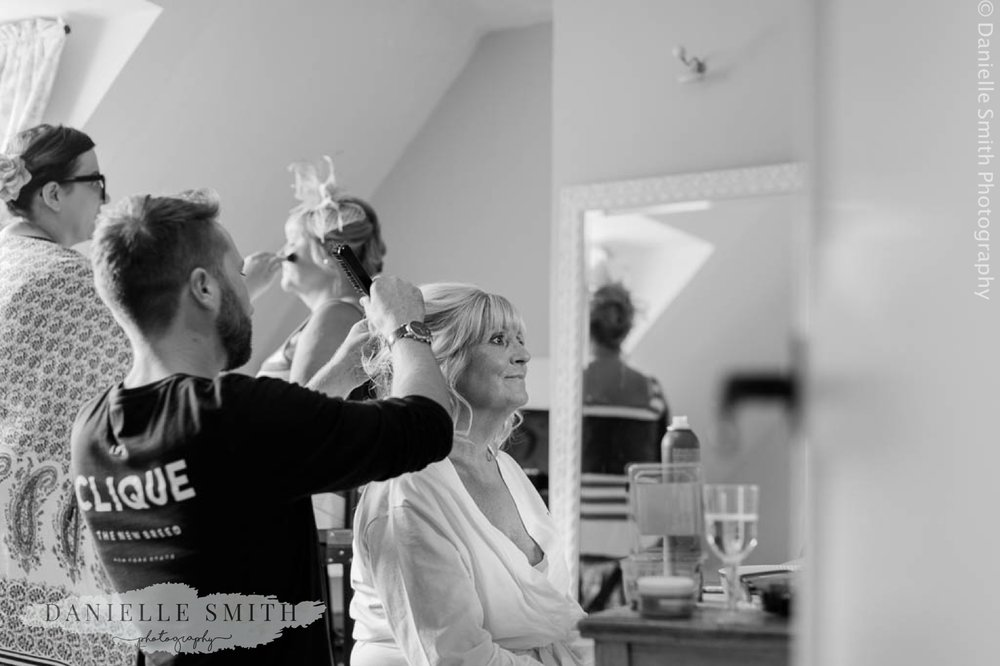 bride having her hair done at houchins wedding