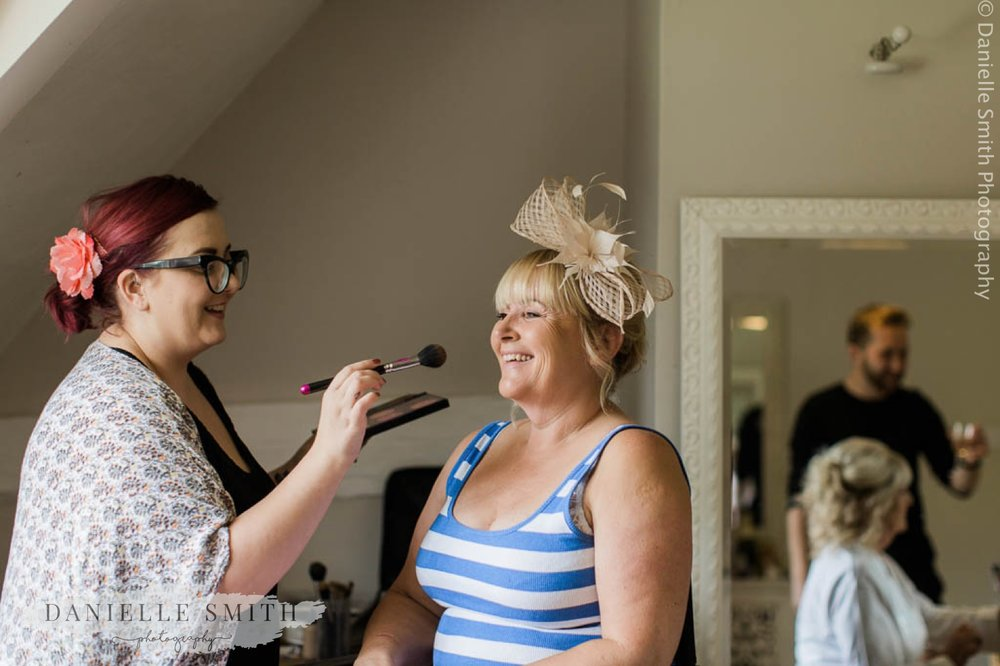 wedding guest having her make up done