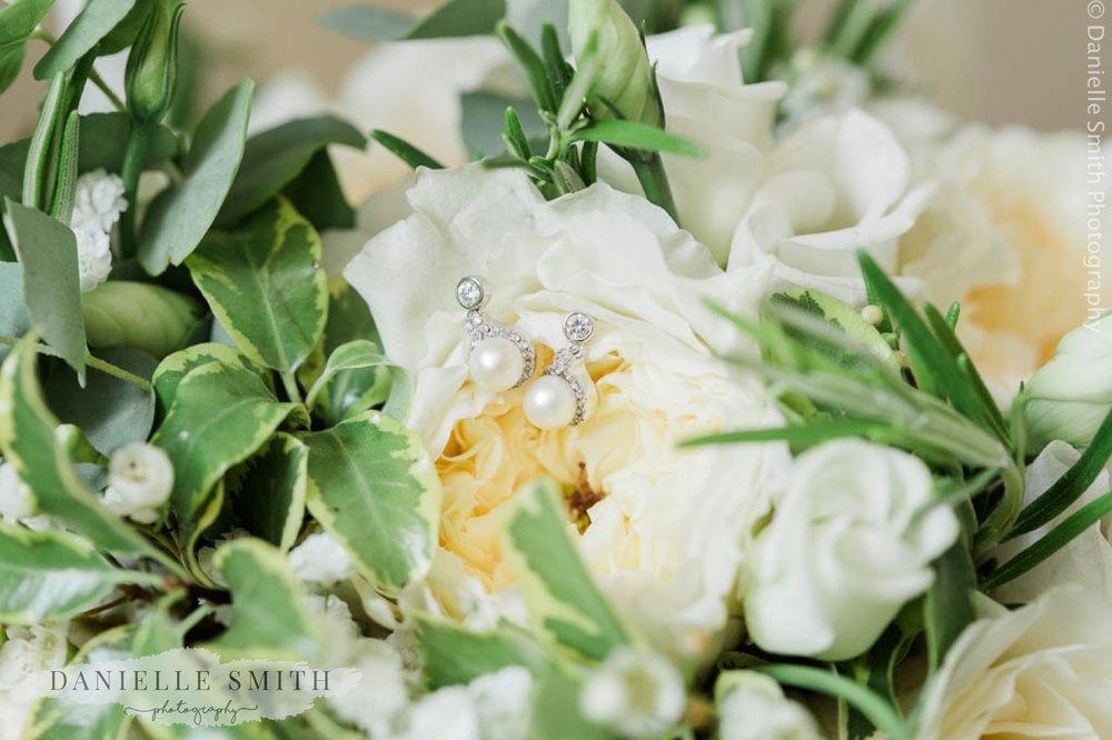 pearl earrings on ivory flower