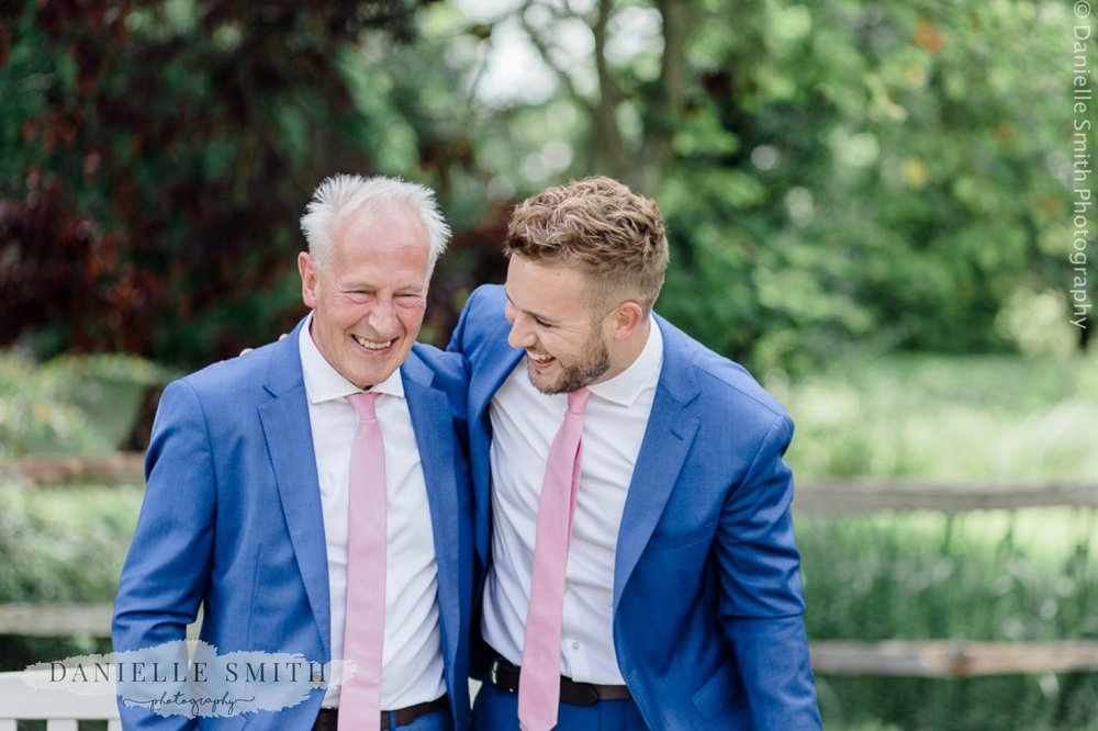 groom and best man laughing at houchins wedding venue
