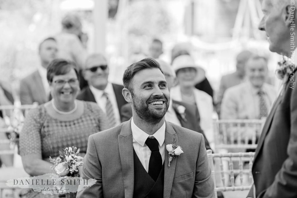 man laughing during ceremony