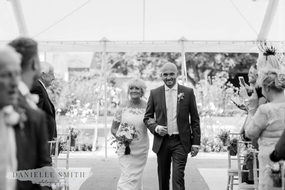 son walking his mum down the aisle - houchins wedding photography
