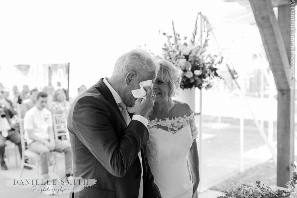 groom crying and bride smiling