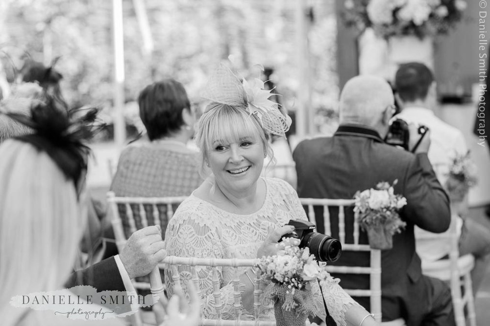 wedding guest with camera in hand