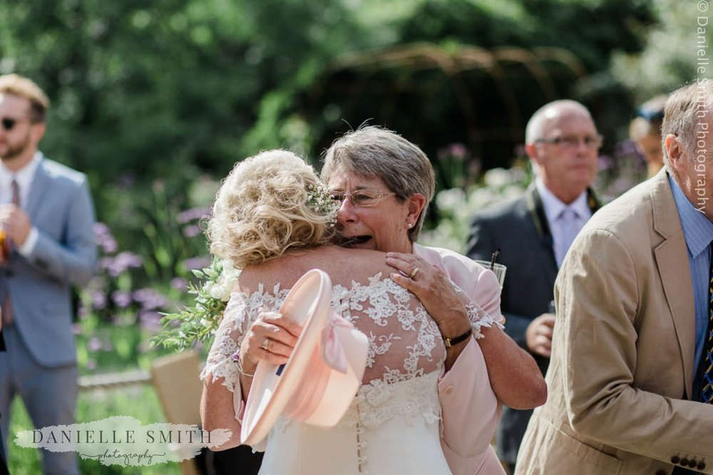 new sister in law hugging bride