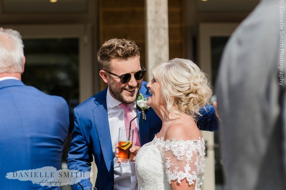new son in law laughing with bride