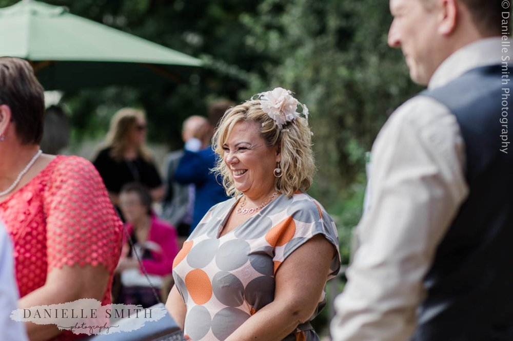 wedding guest laughing - houchins