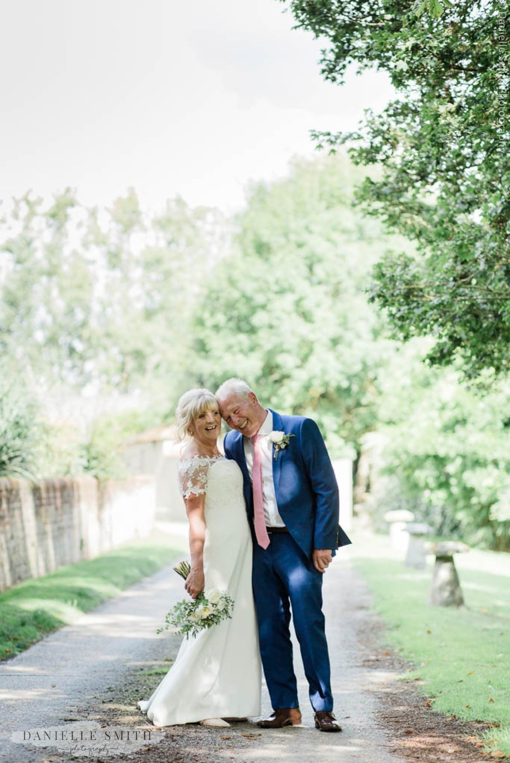 bride and groom laughing - outdoor wedding