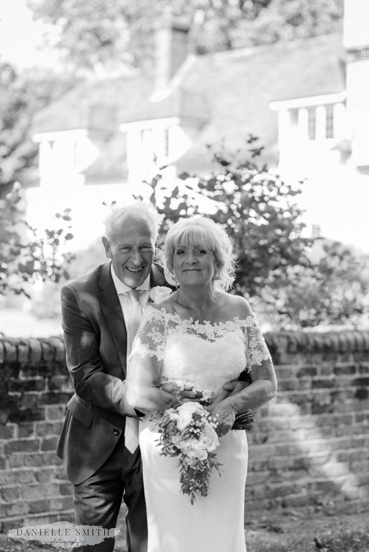 older bride and groom smiling at houchins