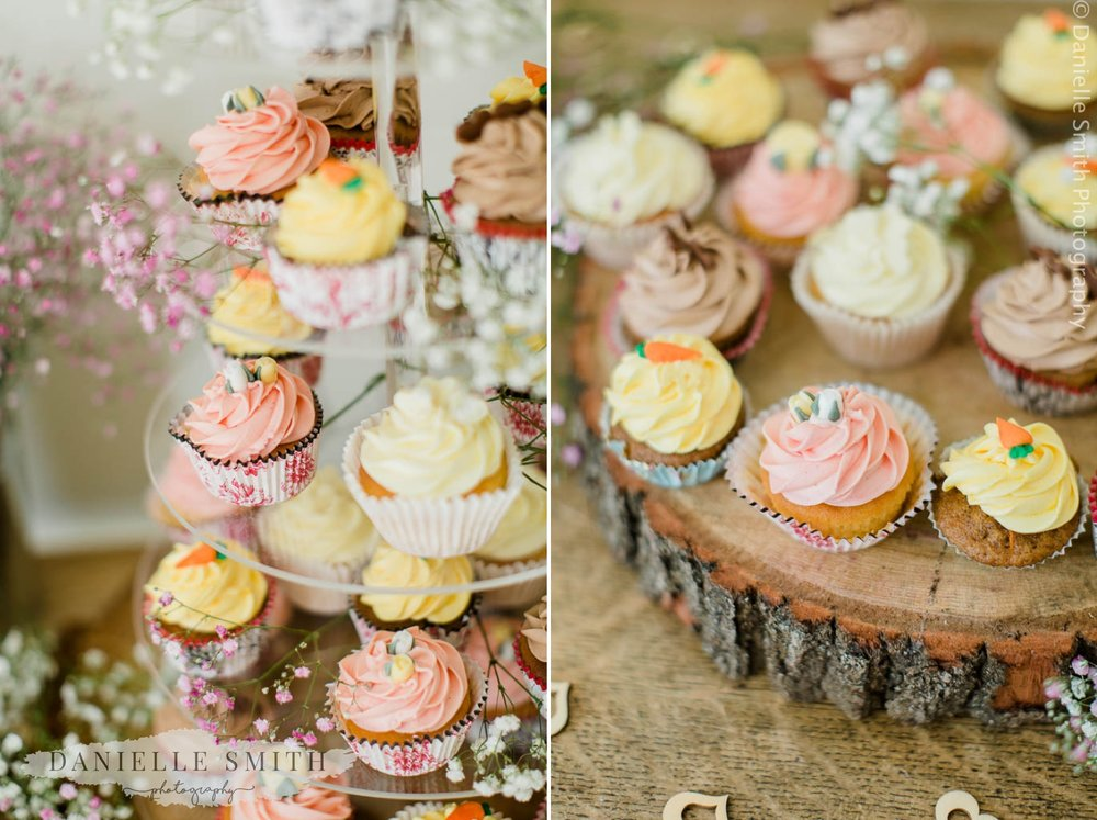 pastel colour cupcakes at rustic wedding