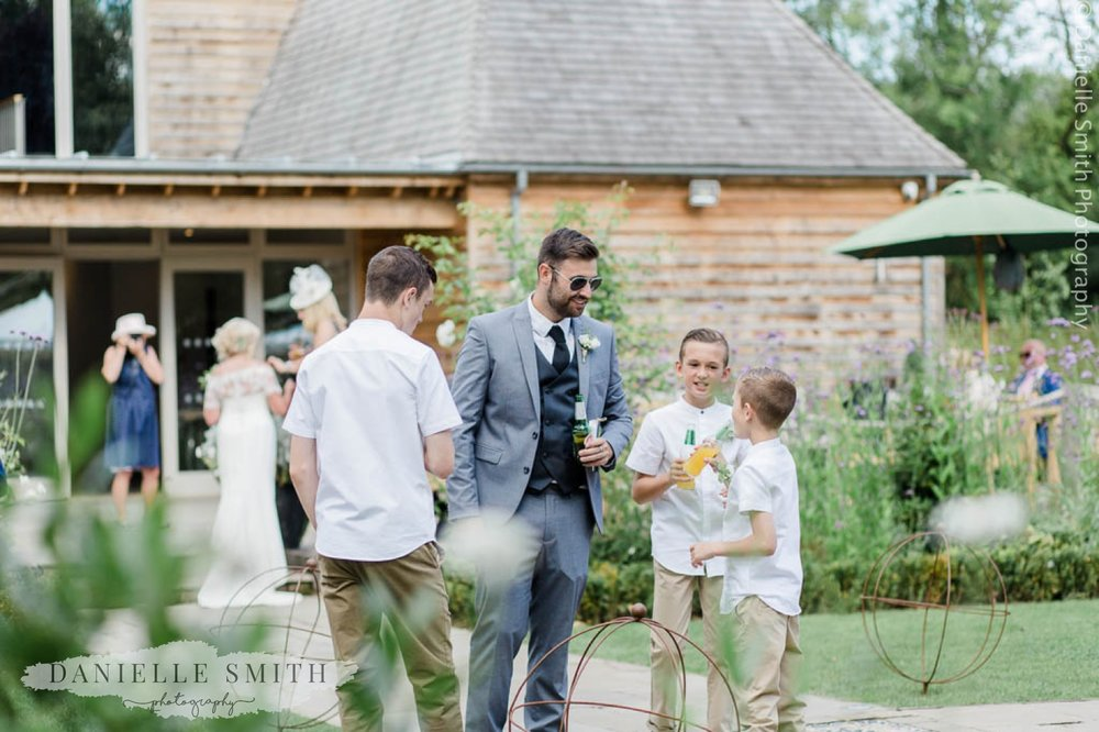page boys and wedding guests in gardens