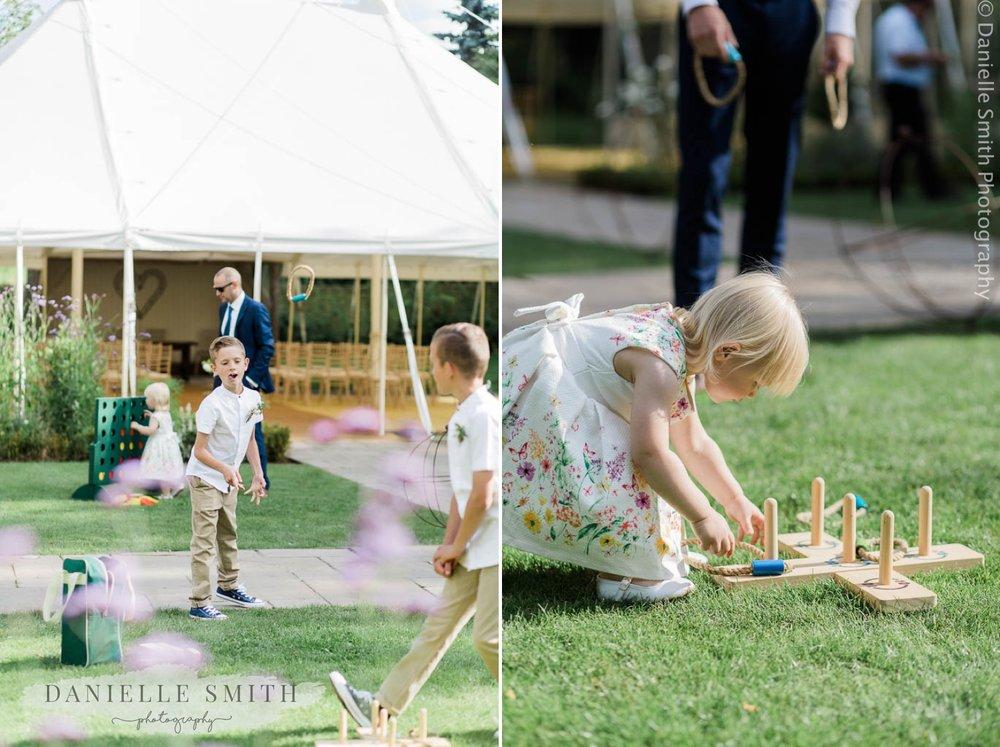 children playing garden games at outdoor wedding