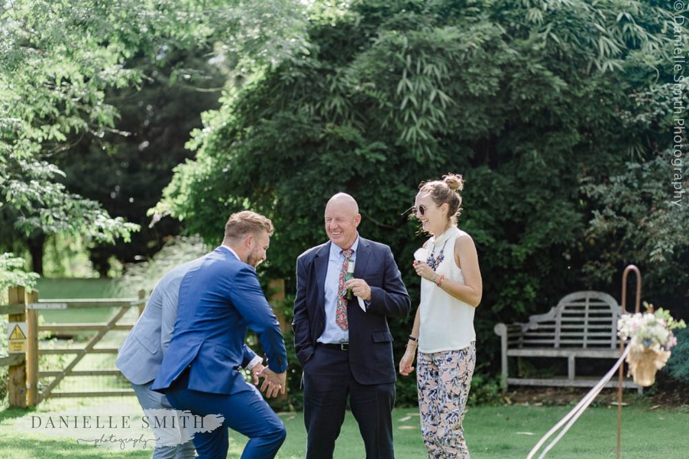 wedding guests laughing at outdoor wedding
