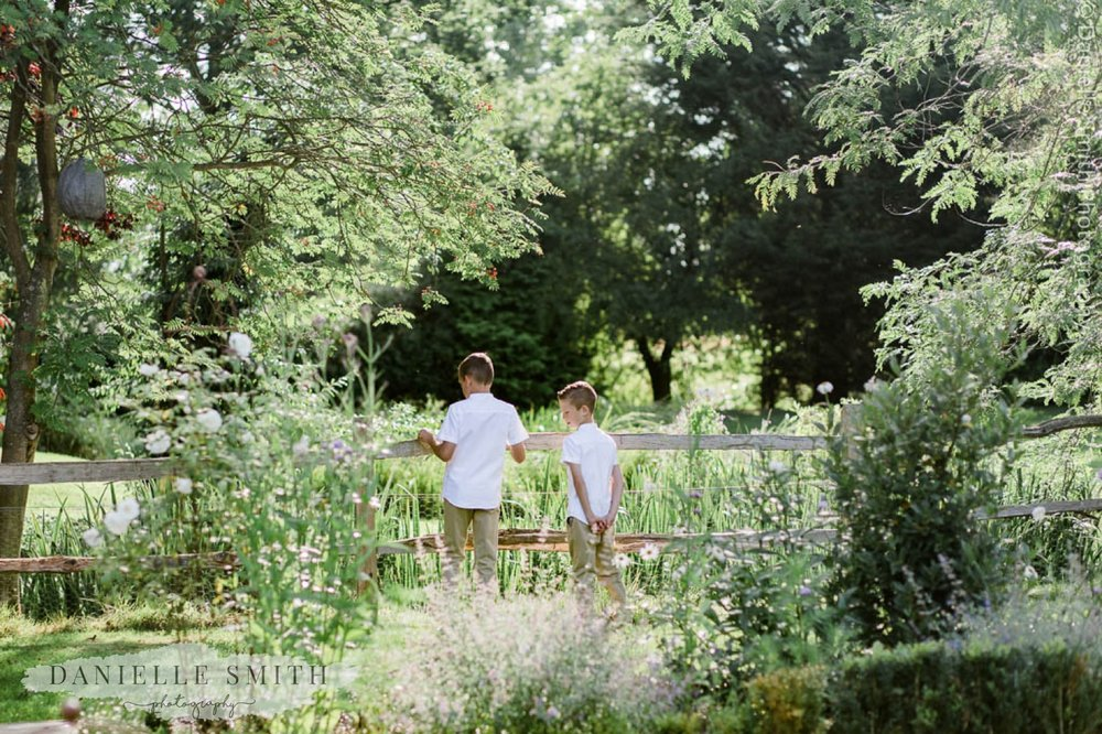page boys standing in gardens - houchins wedding photographer