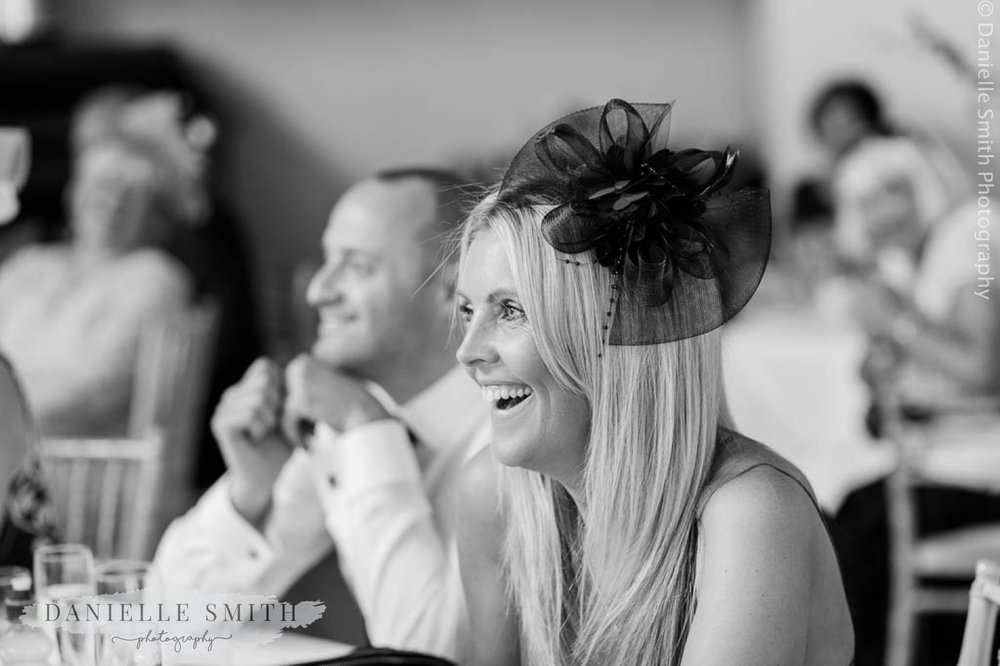 wedding guest laughing during speeches at houchins