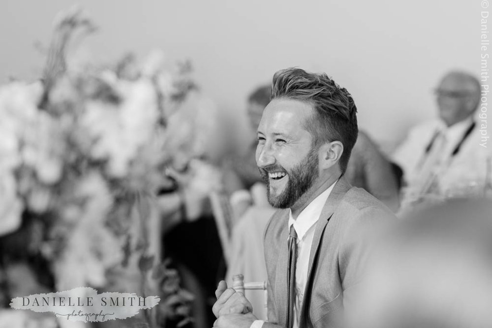 man laughing at speeches