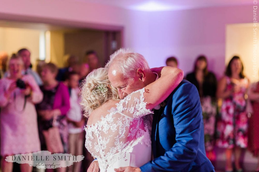bride and groom hugging during first dance - houchins wedding