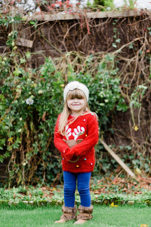 little girl in red xmas jumper