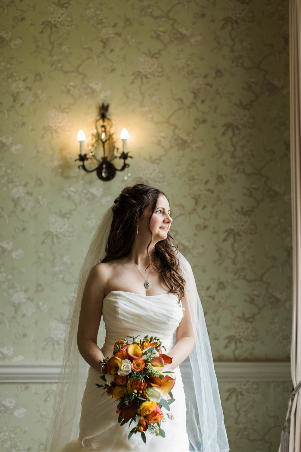 bride with autumn bouquet - morden hall wedding