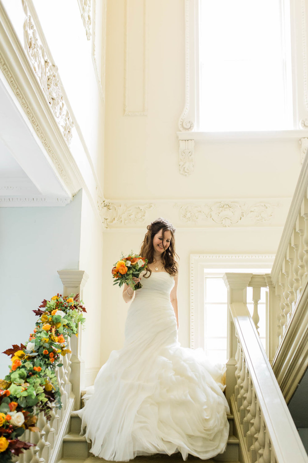 bride walking down stairs - autumn wedding