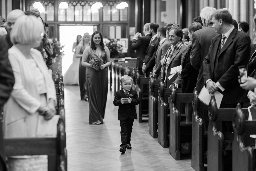 page boy walking down aisle