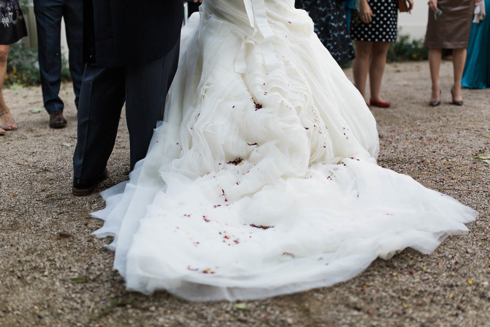 confetti on brides dress