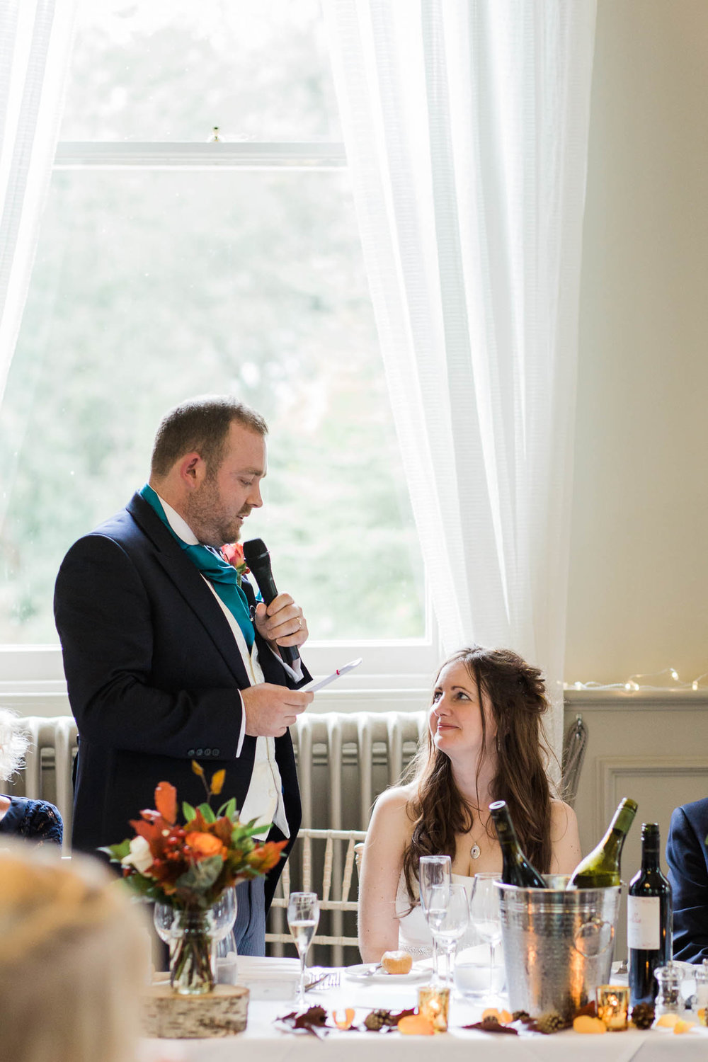 groom speaking to his wife during speech - morden hall wedding