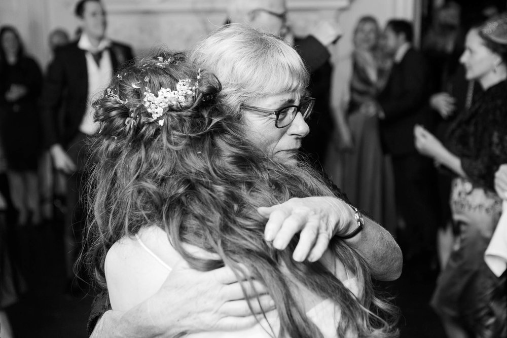 bride hugging mother in law