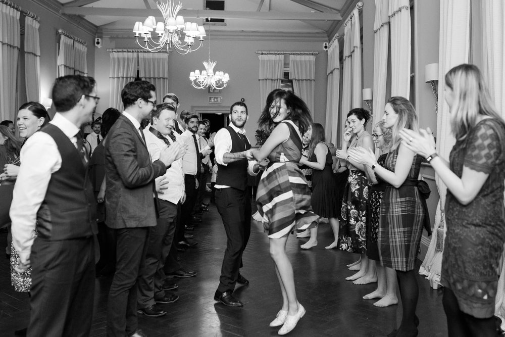 wedding guests dancing to ceilidh band - morden hall wedding