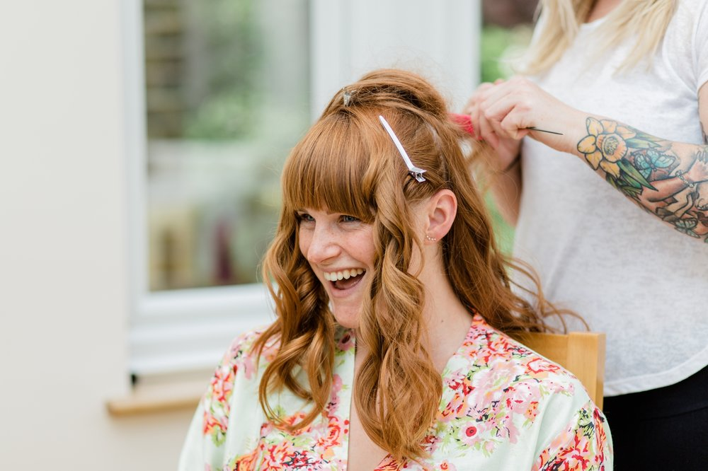 bridesmaid having her hair done - relaxed marquee wedding