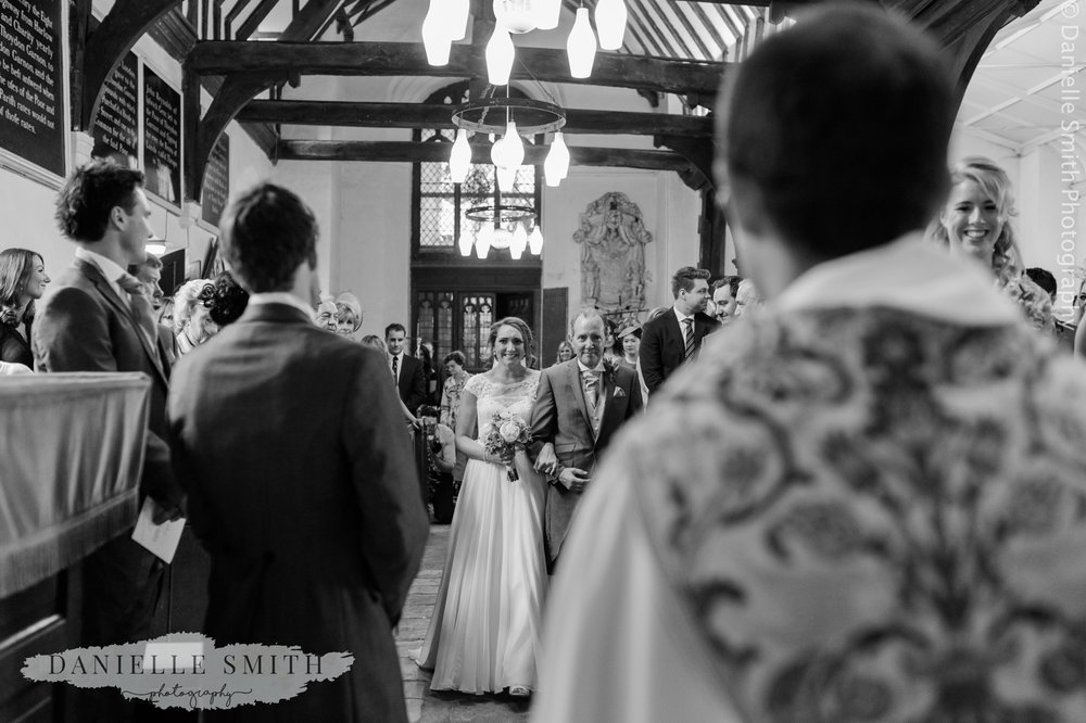 bride and her dad waking down aisle